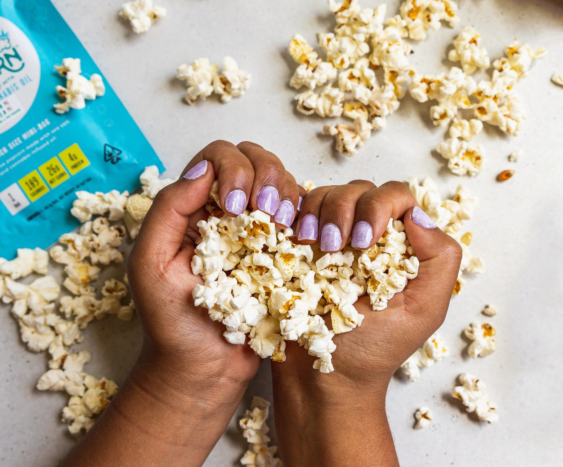 A heart-shaped fistful of popcorn