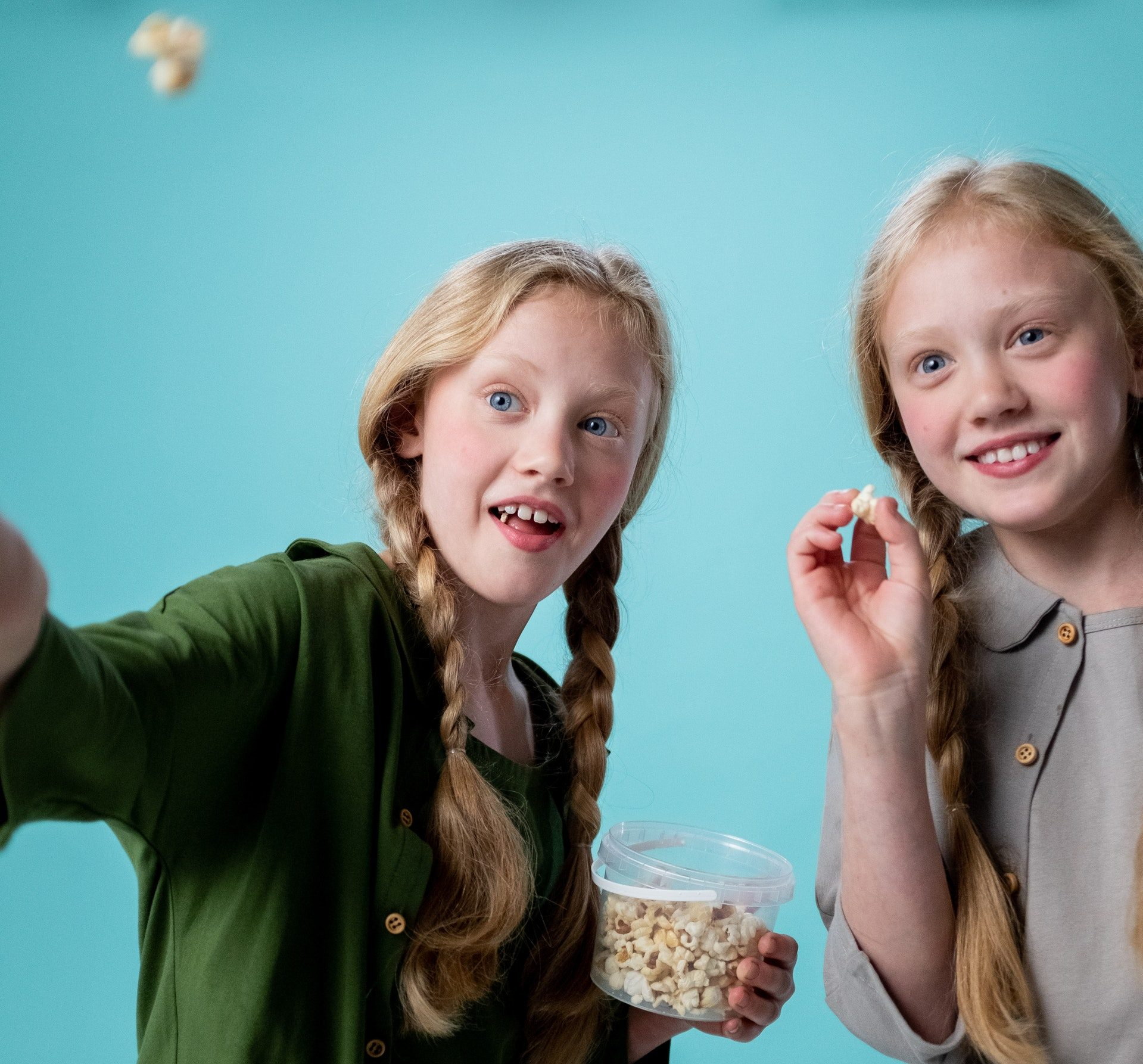 Children playing with popcorn